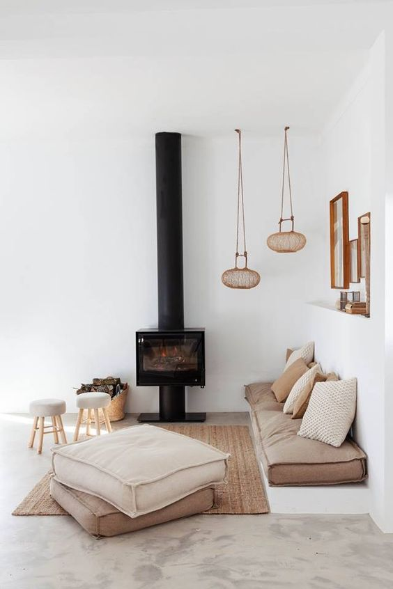light brown floor cushion with throw pillows a couple of floor pillows small stools modern black fireplace unique pendant lamps