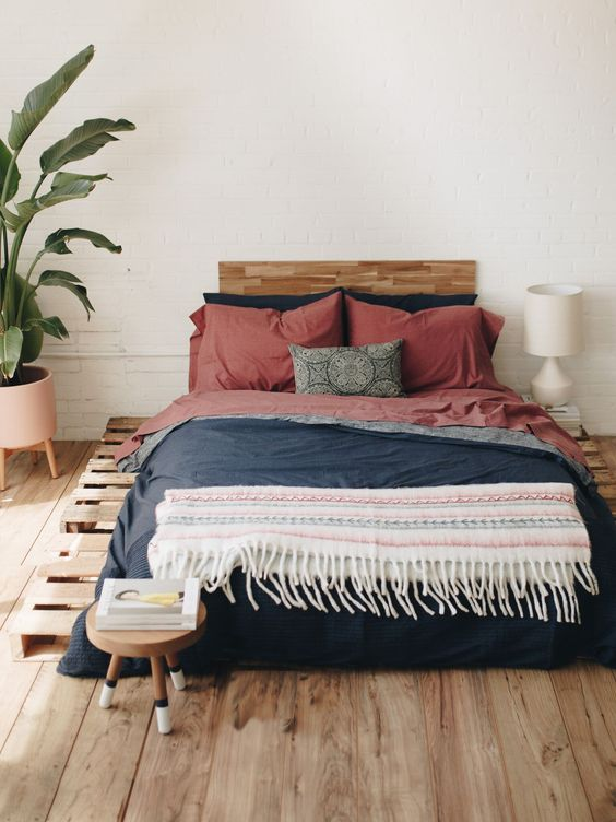 low profile platform bed frame with headboard blush pink planter with legs with medium size houseplant wood floors