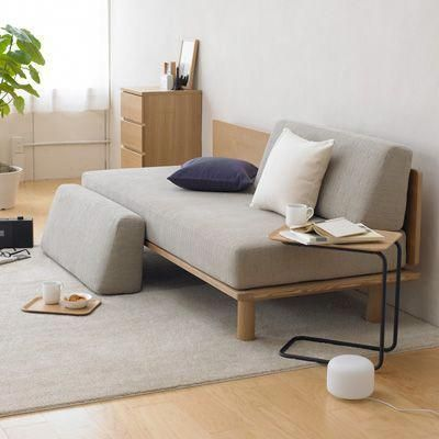minimalist daybed with gray cushion and light wood frame gray area rug modern side table with wood top and black metal frame