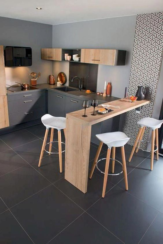 modern breakfast nook wood bar table modern bar stools gray kitchen cabinetry and countertop