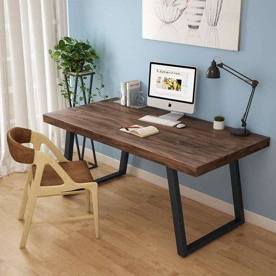 modern industrial working table light wood working chair with earthy brown accent light wood floors