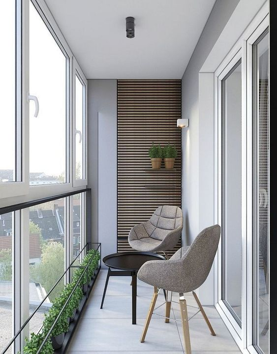 modern minimalist balcony idea modern chairs in gray round top coffee table in black glass windows textured wood wall panel with greenery on the shelves