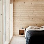 Modern Minimalist Bedroom Design Plywood Walls And Ceilings Recessed Shelving Unit Glass Window White Bed Linen Black Duvet Cover