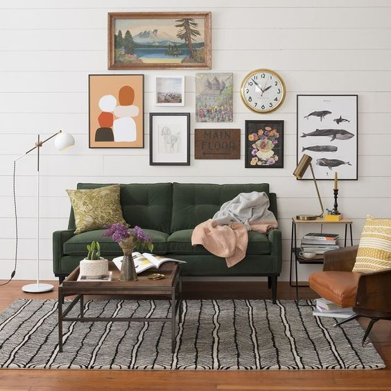 modern sofa with tufted upholstery in deep green dark wood coffee table area rug with modern pattern minimalist floor lamp some wall decors