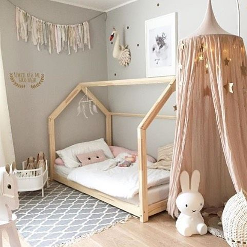 playfull indoor tent with blush pink draperies light wood tent bed frame white bed linen white duvet cover vintage area rug with tassels