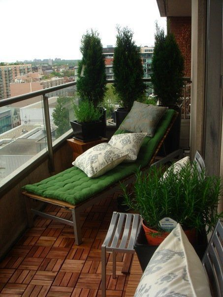 reclining chair with green cushion mini garden on balcony