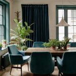Semi Formal Dining Room Blue Velvet Dining Chairs Hardwood Dining Table Blue Draperies Wood Floors
