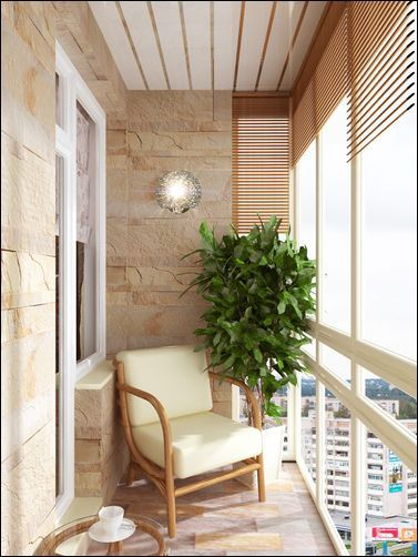 stoned walls in cream stoned floors in cream corner chair corner potted houseplant light wood window shutter round glass top side table