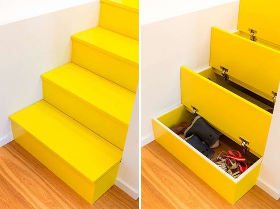 stunning yellow stairs with pull out storage units