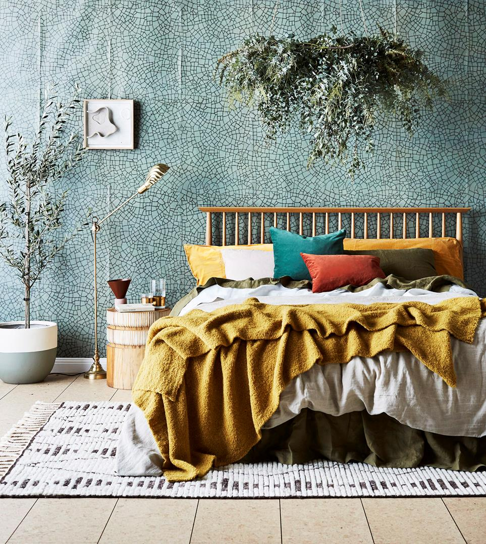 terrazzo tile flooring idea midcentury modern bed frame with railing like headboard vintage rug with fringed tassels