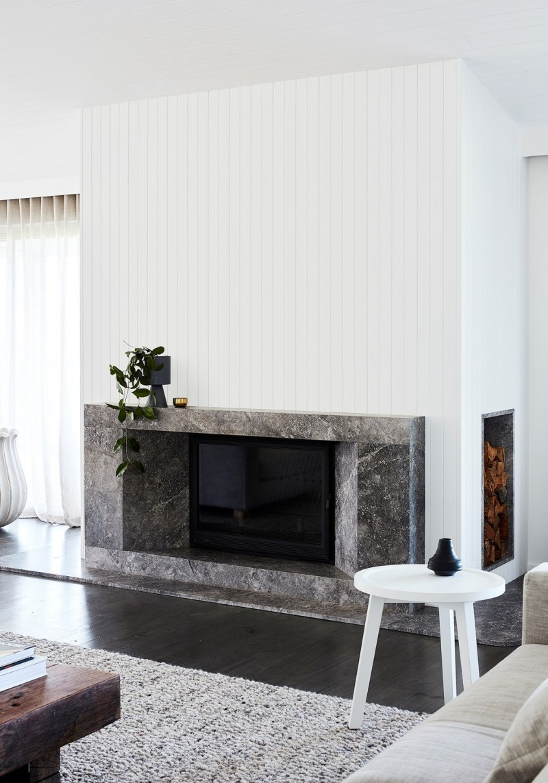 wall cladding in white right above the fireplace