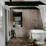 White Bathtub Wood Plank Flooring Wood Plank Walls And Hidden Storage Solution Recessed Bathroom Vanity With Under Cabinet And Marble Backplash