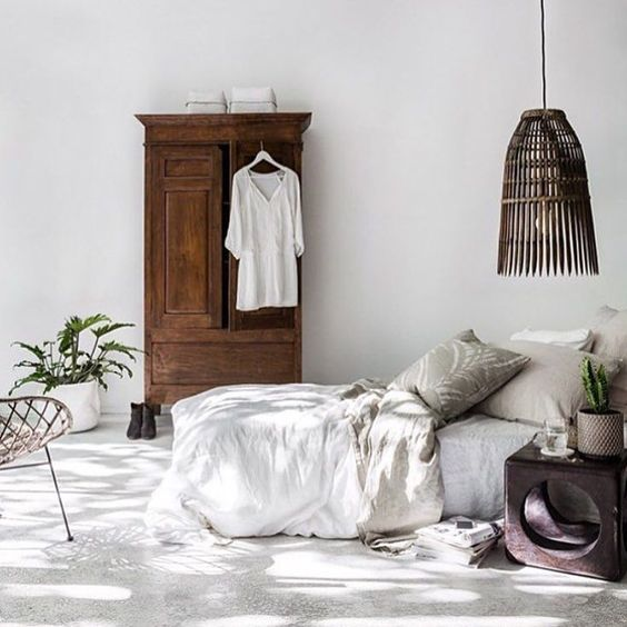 white bed linen and duvet cover worn out wooden closet oversized pendant with worn out wood lampshade
