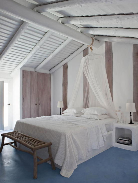 white painted wood beams and ceilings all white bedding treatment white canopy curtains wood bench bed blue floors