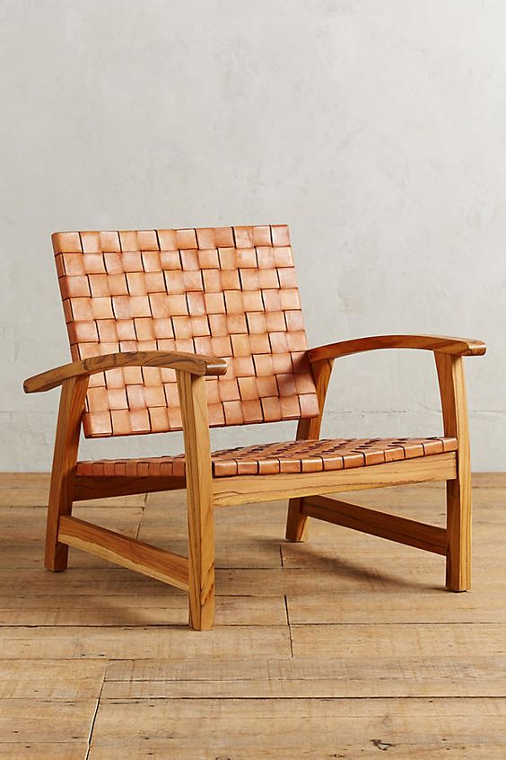 Anthropologie's chair with oak frame and leather belt upholstery