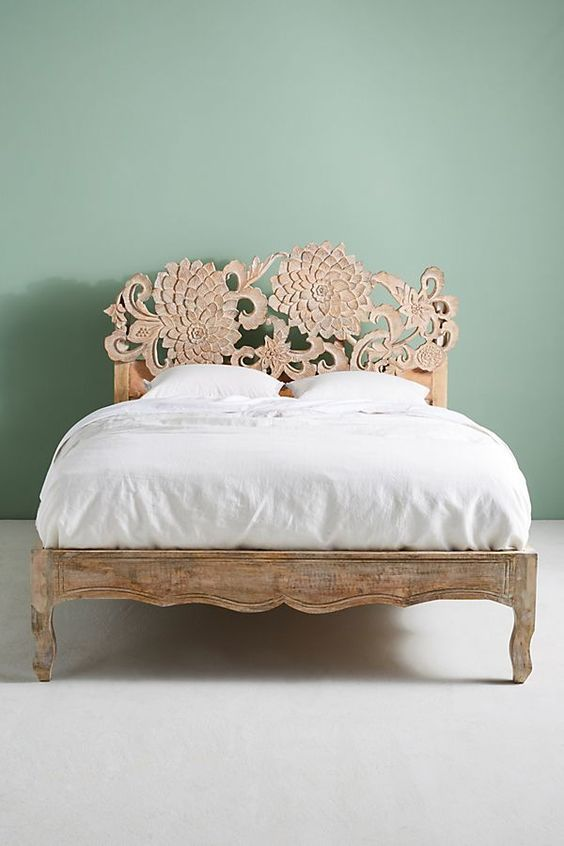 Anthropologie's wood bed frame with handcarved Lotus headboard