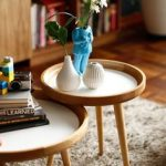 A Couple Of Small Coffee Table With Round Shaped And Deeper Top And Angled Legs