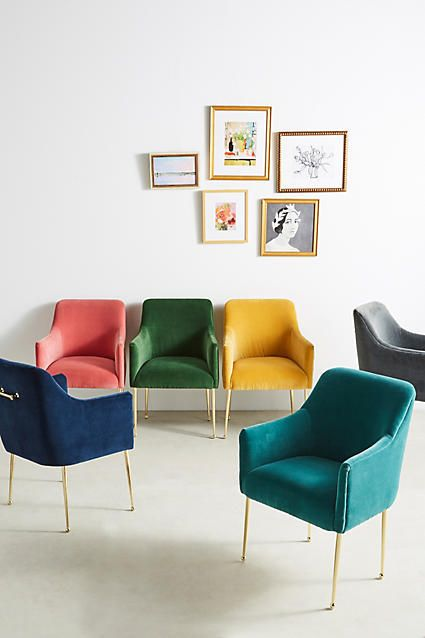 accent chairs by Anthropologie with colorful velvet upholstery and brass legs