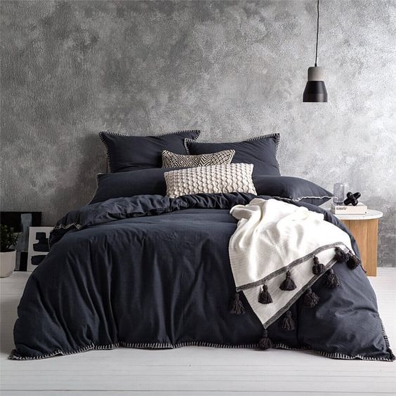 black washed finish walls light gray floors charcoal toned bedding treatment