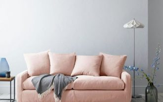 blush sofa with blush throw pillows and gray throw blanket gray runner gray washed wood plank floors