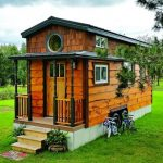 Calm And Cozy Tiny House With Shingled Exterior Walls Wooden Railing System With Green Exterior Pillars