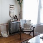 Corner Seating Area Chair With Some Throw Blankets And Bohemian Throw Pillow Macrame Wall Decor Hanging Houseplant