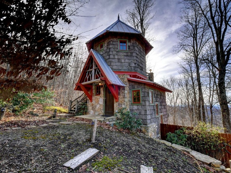 fairytale lighthouse design with weathered shingles wall in gray accented with red beams