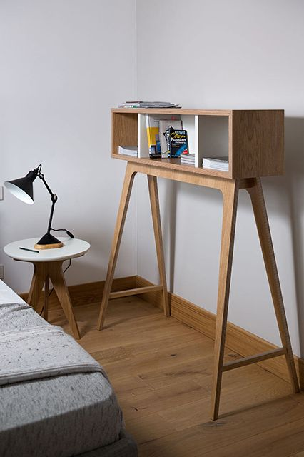 full height shelving unit made of light wood material