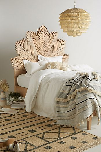handcarved Albaron bed frame with Moroccan inspired motif headboard and footboard