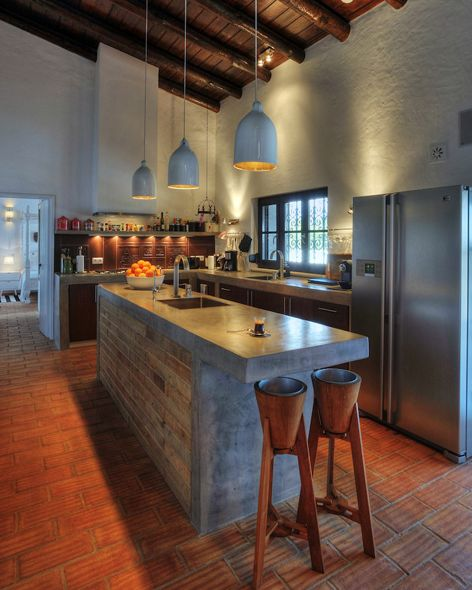 industrial rustic kitchen design concrete kitchen island textured terra cotta tile floors textural concrete walls in white modern industrial pendants