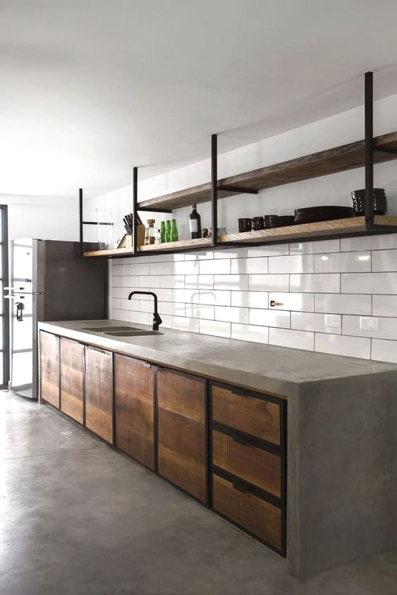industrial rustic kitchen white subway ceramic tile backsplash concrete countertop hardwood cabinetry hardwood open shelves with black wrought iron frame