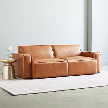 leather sofa in ultra modern design brass side table white area rug