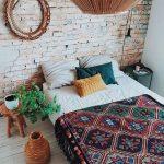 Modern Bohemian Bedroom Design White Bed Linen Ornate Blanket With Ethnical Patterns And Fringed Tassels Oversized Pendant Round Top Side Table Ornate Vase Carved Wood Frame