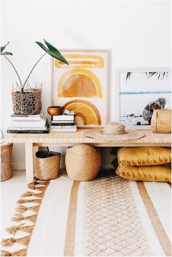 mustard throw pillows woven works wooden table nest like planter with fresh and vivid plants artsy abstract painting with soft frames