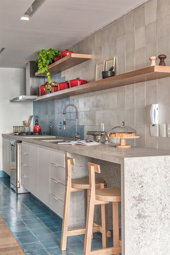 simple and modern kitchen light gray tiled backsplash wooden open shelving units gray stone kitchen countertop light wood stools