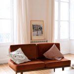 Simple Midcentury Modern Sofa In Earrthy Brown White Area Rug