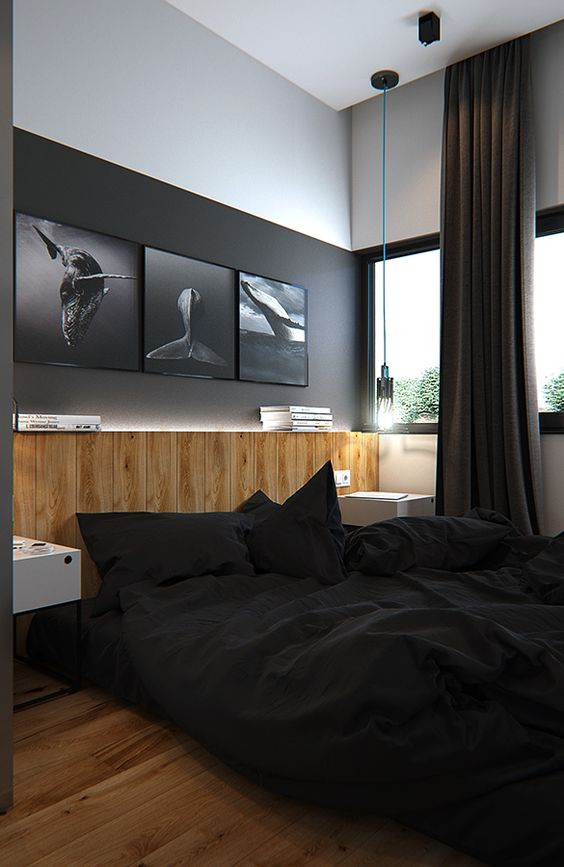 ultra modern bedroom in black wood media console table and floors black white walls with modern wall arts black bedding treatment black draperies