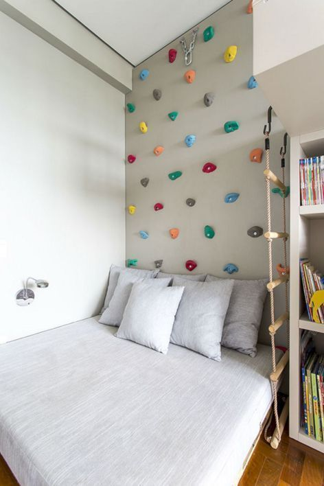 Montessori themed boy's room crisp white bed linen and pillows white book shelves