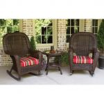 A Couple Of Dark Toned Rattan Rocking Chairs With Colorful Cushion Addition Round Top Rattan Side Table