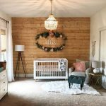 Baby Crib In White Wood Cutout Wall White Area Rug Light Gray Nursery Chair Tripod Leg Floor Lamp With White Lampshade