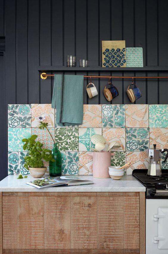 bold and colorful floral tile backsplash marble countertop wooden cabinets