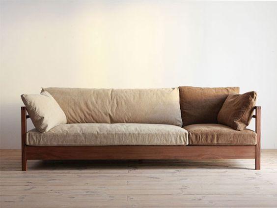 clean line wood sofa with neutral cushion