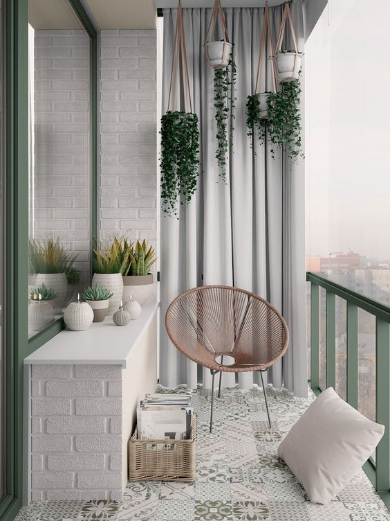 dream balcony hanging greenery on white planters egg chair in light wood tone white area rug with motifs crisp white brick walls broken white outdoor curtains