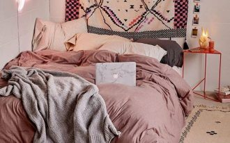 dusty pink comforter pastel pillows gray throw blanket pastel area rug with black patterns pastel backdrop with bold patterns