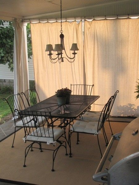 large veranda with drop cloth in shabby white outdoor dining furniture set with tufted cushion on each chair