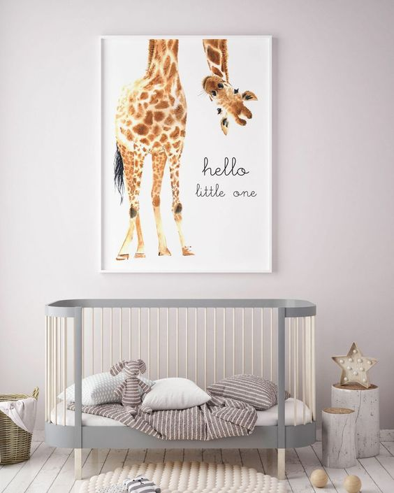light gray and white baby crib in low profile design squishy rug in white ornate log side tables in white giant girafe print wall art