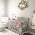 Light Gray Baby Crib Superlight Gray Walls Crisp White Nursery Chair Crisp White Rug Superlight Gray Knitted Pouf