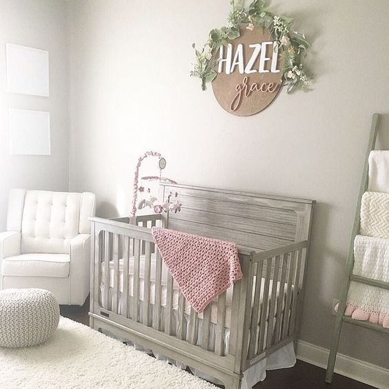 light gray baby crib superlight gray walls crisp white nursery chair crisp white rug superlight gray knitted pouf