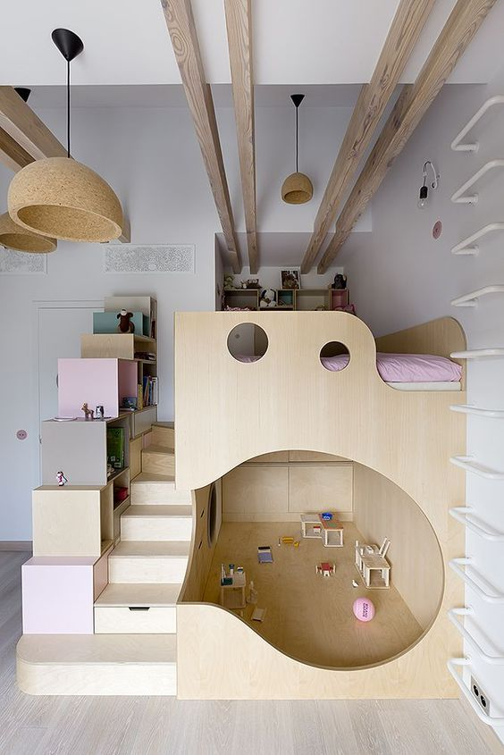 loft bed with under playroom and extra storage solutions crisp white walls exposed wood beams ultra light wood floors