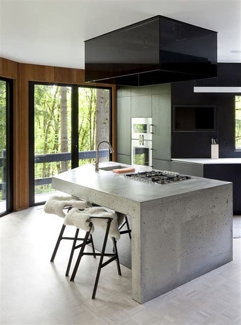 low cost yet modern concrete finish kitchen island with faucet and sink planted stove and modern stools